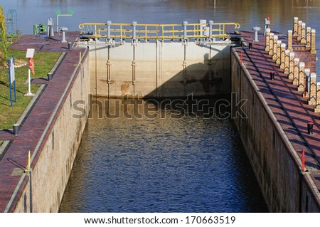 lock gates of the water dam in river  - stock photo