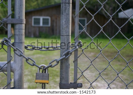 Lock hanging on gate - stock photo