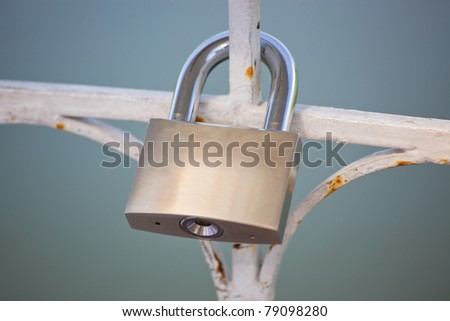 lock hanging on the fence - stock photo
