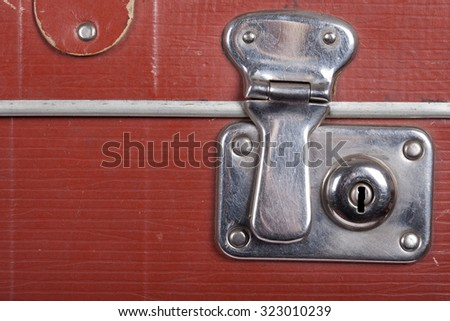 Lock of an old brown suitcase - stock photo
