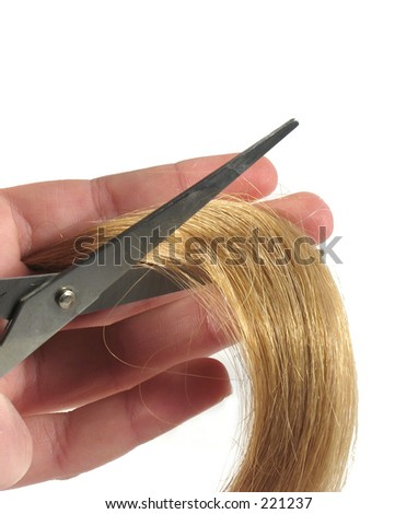 lock of hair with scissors on white background