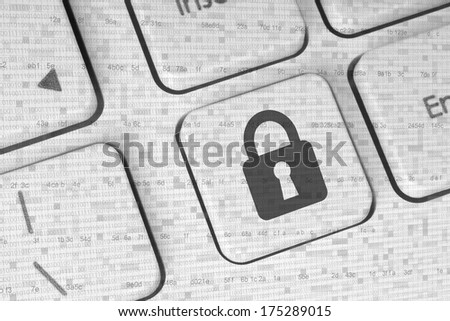 Lock on a white keyboard, security concept  - stock photo