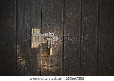 lock on a wood door - stock photo