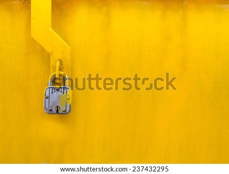lock on a yellow door - stock photo