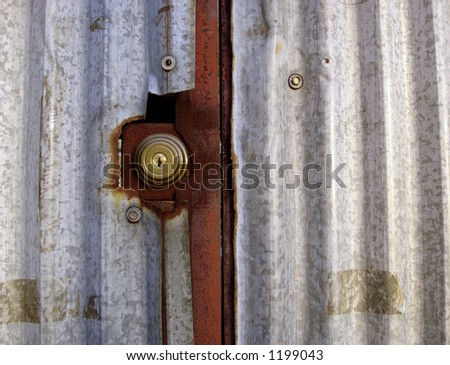 lock on an old rusty metal structure