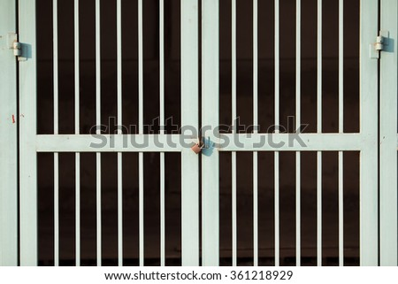 Lock on green metal fence background - stock photo