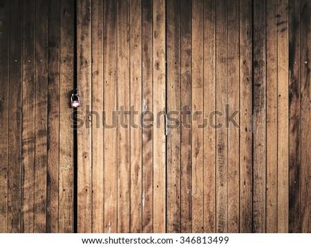 lock on old wood door - stock photo