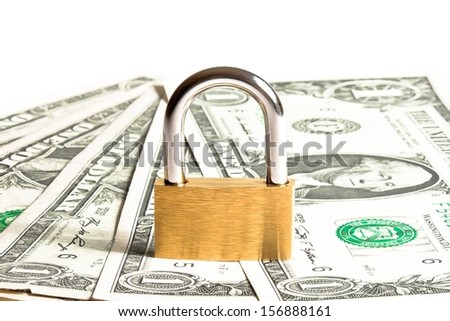 lock security on dollars banknotes with space for text. Money for safety and investment. - stock photo