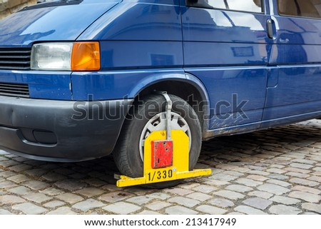 Lock wheel of illegally parked car on the street - stock photo