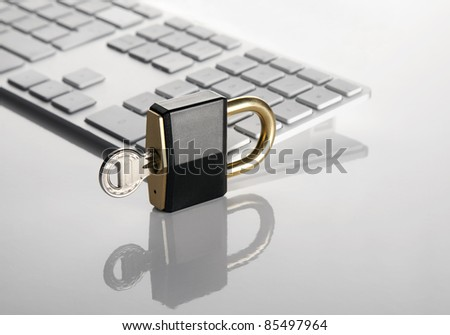 Lock with key and keyboard - stock photo