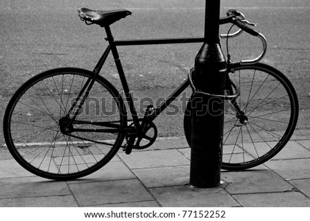 Locked bike in the street - stock photo