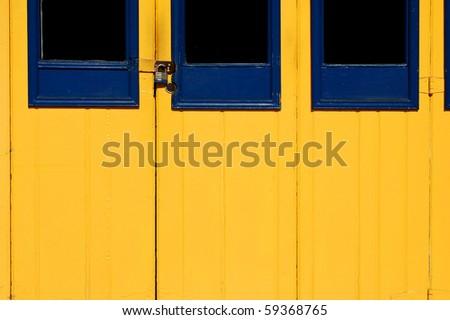 "Locked blue and yellow wooden doors; ""Spanish Village Art Center""; Balboa Park; San Diego, California - stock photo"