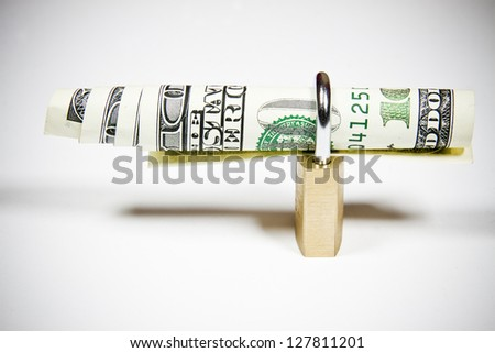 Locked dollar banknotes isolated on white - stock photo
