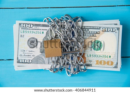 locked dollar money by metal chain link with padlock - stock photo