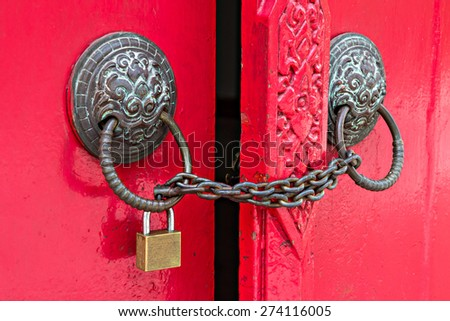 locked door by chain and padlock - stock photo