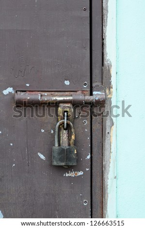 Locked door of iron on the wooden door