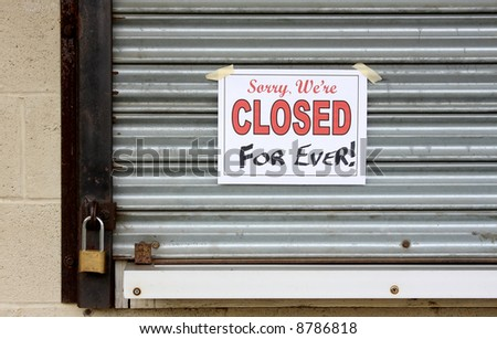 Locked door on a business that has gone bankrupt - stock photo