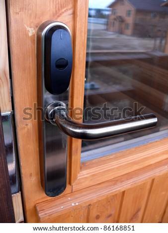 Locked door with keycard identification system - stock photo