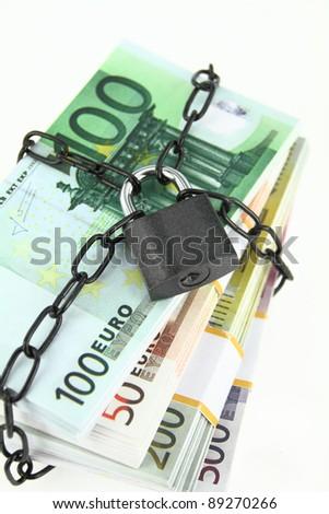 Locked money on white background - stock photo
