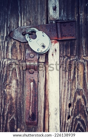 Locked old wooden door - stock photo