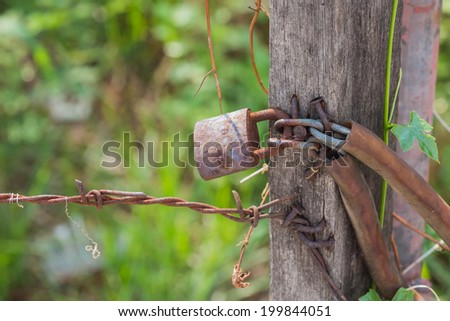 locked on wire fence - stock photo