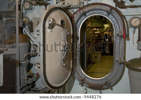Locked submarine hatch metal door at end of hallway navy & Locked Submarine Hatch Metal Door End Stock Photo (Royalty Free ...