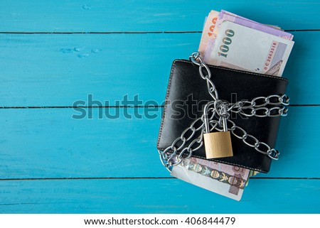 locked thai money purse with metal chain link with padlock - stock photo