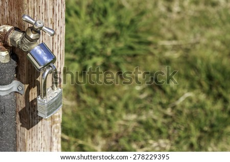 Locked water spigot in a California Park due to the water drought - stock photo