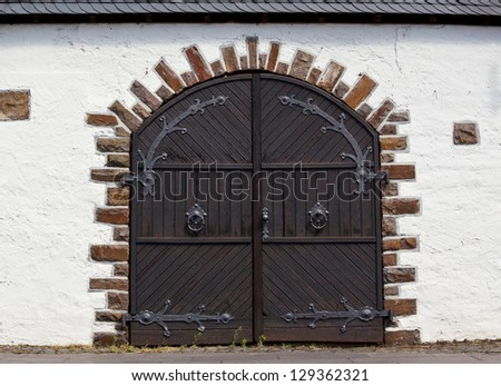 locked wooden door with round doorknobs - stock photo