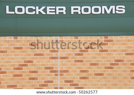Locker Rooms sign at a football field - stock photo