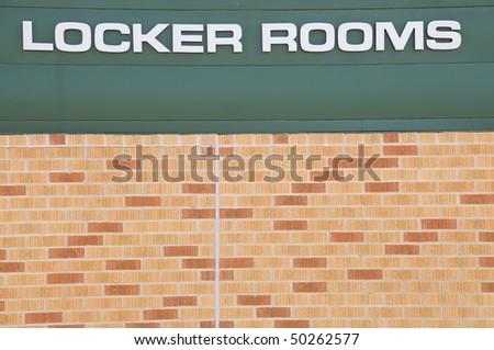 Locker Rooms sign at a football field - stock photo