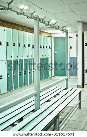 Lockers and benches in a sports centre changing room - stock photo