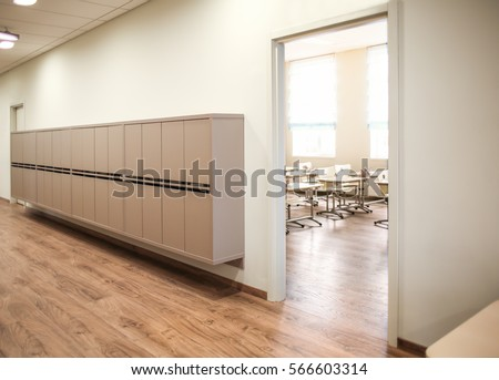 Lockers in empty school hallway