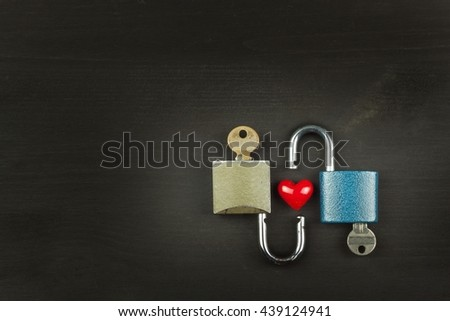 Locks and keys on a wooden table. New Symbol of love and happiness. Lock and heart. Key to the heart. Locked love. Harmony of souls. - stock photo