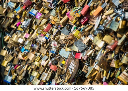 Locks of love at Paris bridge - stock photo