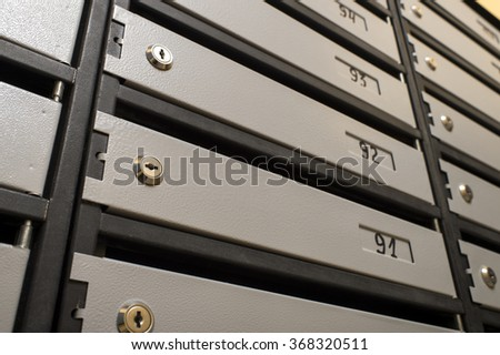 locks of metal mailboxes - stock photo