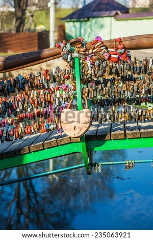 Locks on railing of bridge, which hang brides and grooms. - stock photo