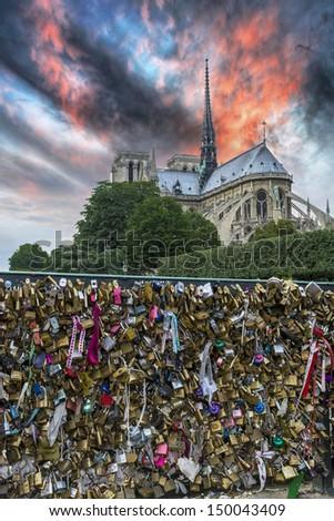 Locks on the bridge in Paris with beautiful sky. - stock photo