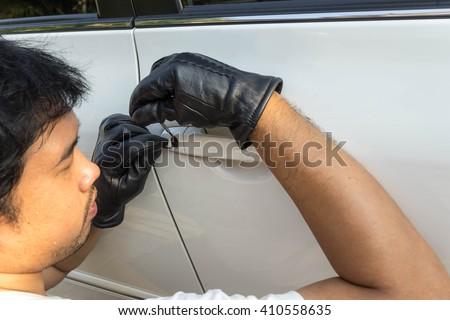 locksmith car try to open the door on black grove  - stock photo