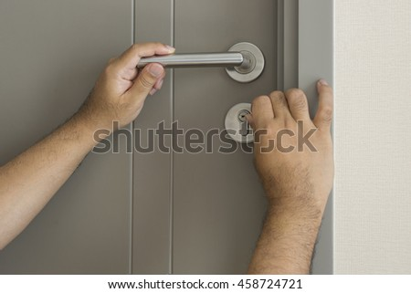 locksmith try to open the door by technique with screwdriver - can use to display or montage on product - stock photo