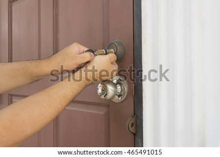 locksmith try to use cylinder key for open the door - can use to display or montage on products