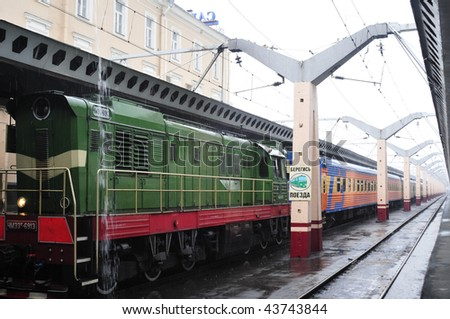 Locomotive beside the platform, rainy day. - stock photo