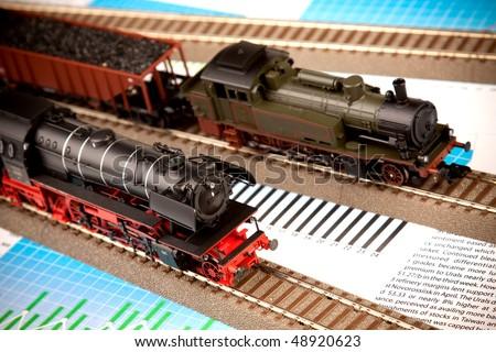 Locomotive models on railroad on diagram - stock photo
