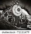 Locomotive number nine with dramatic sky - stock photo