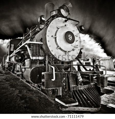 Locomotive number nine with dramatic sky - stock photo