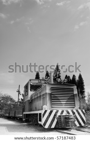 Locomotive of discard under sky in black and white tone. - stock photo