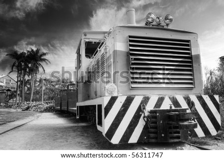 Locomotive of old discarded train under dramatic sky. - stock photo