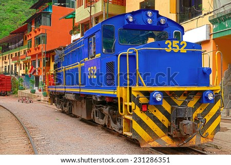"Locomotive stands at the railway station of ""Aguas Calientes"", the suburb of ""Machu Picchu"" - stock photo"