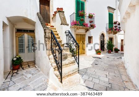 Locorotondo, Italy. Medieval whitewashed street and houses in small city of Puglia, Apulia, Bari region. - stock photo