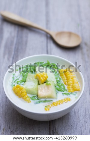 Lod Chong Dessert in Coconut Milk with wood spoon on wood table ,Thai dessert